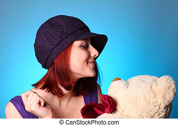 Beautiful girl with teddy bear at St. Valentine's Day