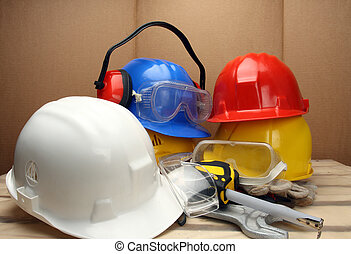 Safety concept - Some worker's helmets close up. Safety...