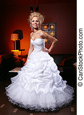 Young and beautiful bride in wedding dress - Young and...