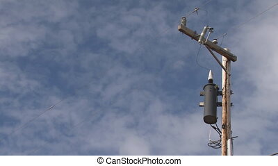 Power Pole Transformer Clouds - A moderate time-lapse of...