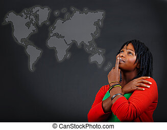 African woman and world map - young African American woman...