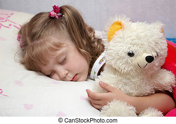 girl slipping - A little girl sleeping with a toy