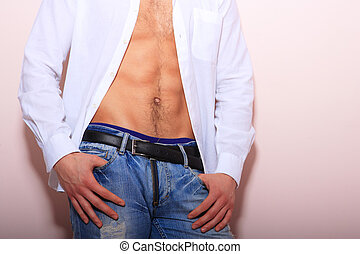 young man with unbuttoned shirt - portrait of a young man...