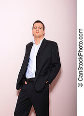 business man standing - Full length of young business man...