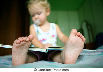 Cute baby - An image of a baby girl reading a book