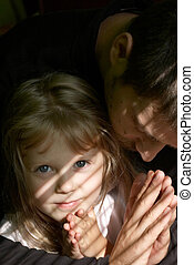 To pray - An image of father teaching her daughter to pray