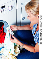 Housewife washing - A young housewife with washing machine...