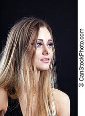 Young amazing blond girl look at light