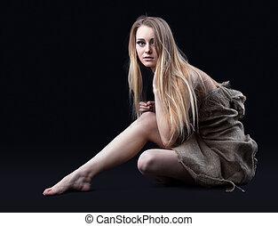 naked girl in hessian sit in dark