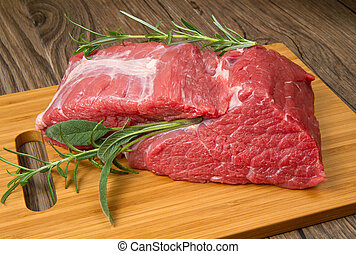red meat - huge red meat chunk on wooden table