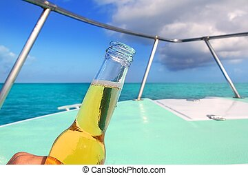 beer on Caribbean boat bow deck turquoise sea