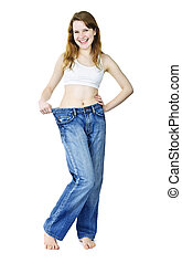 Happy girl in jeans after losing weight