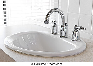 Bathroom sink - Bathroom interior with white sink and faucet