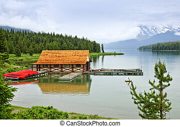 Boathouse on mountain lake - Canoes at boathouse on Maligne...