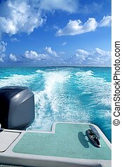 boat outboard stern with prop wash caribbean foam
