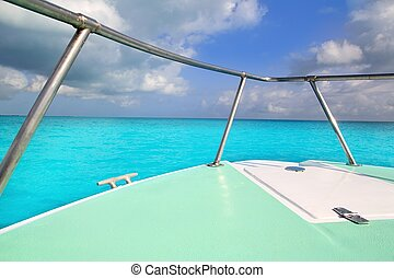 boat green bow in turquoise caribbean sea seascape