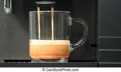 Coffee machine filling a cup with hot fresh coffee....