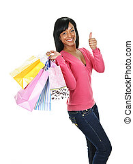 Young happy black woman with shopping bags