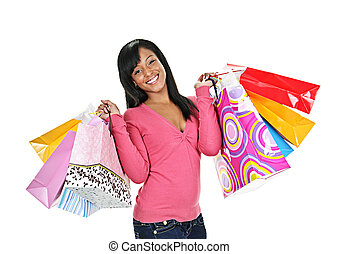 Happy young black woman with shopping bags - Young smiling...