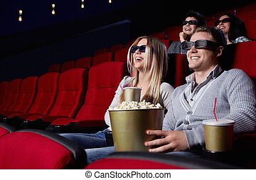 Laughing people at the cinema - Laughing young people in 3D...