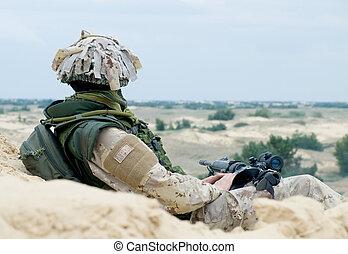 soldier at rest - soldier in desert uniform at rest