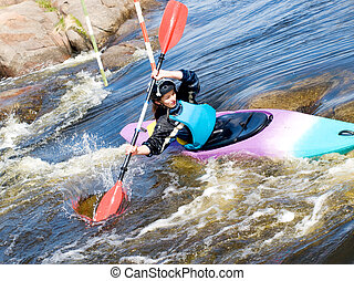 female kayaker - a shot of the female kayaker on the rough...