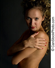 embracing herself - sexy topless blonde girl embracing...