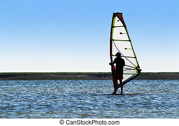 Windsurfer on the background of a coastline