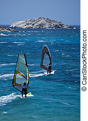 Two Windsurfer make a competition by the coast of greece