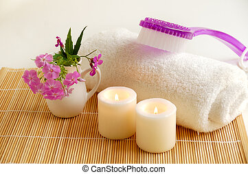 spa still life with lilac brush - white burn candles with...