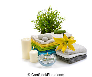 spa towels with yellow lily - stack of colorful towels with...