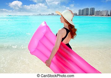 floating lounge pink girl in caribbean tropical beach