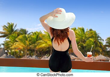 beach hat rear view woman cocktail tropical beach