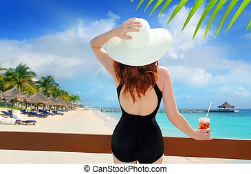 beach hat rear view woman cocktail tropical beach black...