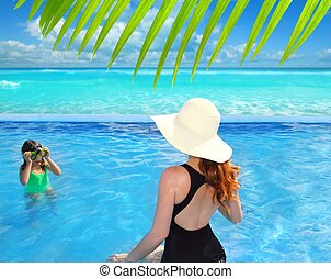 blue swimming pool caribbean view mother daughter - blue...