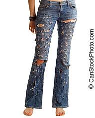 Bare feet of the girl in fragmentary dark blue jeans