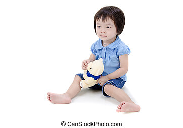 little asian girl holding a teddy bear