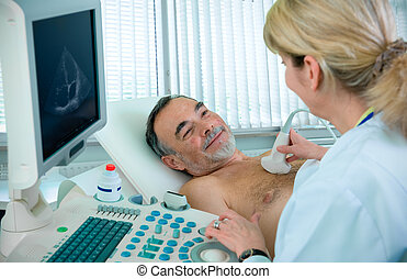 Medical exam - Doctor is using ultrasound machine to scan...