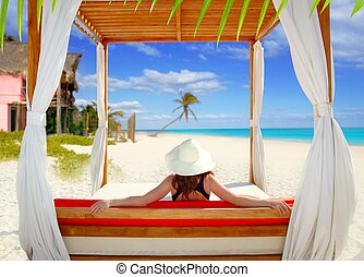 gazebo tropical beach woman rear view looking sea