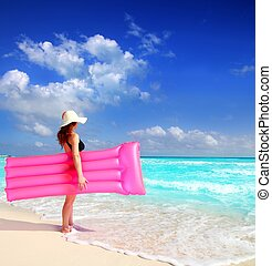beach woman floating lounge pink tropical Caribbean