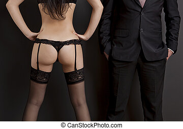 Work and Pleasure - Rear view of a sexy young woman in...