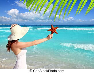 beach hat woman starfish in hand tropical Caribbean - beach...