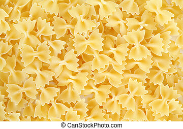 Uncooked pasta - An background of uncooked pasta macro view