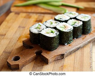California rolls - An image of rolls on wooden plate