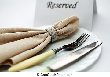 Reserved - An image of knife and fork on a plate