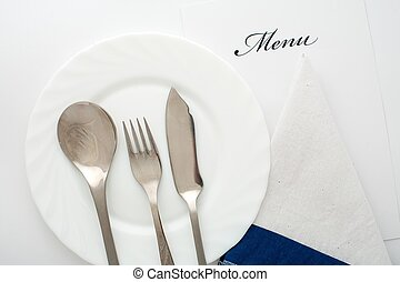 Flatware - An image of fork, spoon and knife on the plate