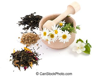 Herbs - An image of wooden mortar with flowers and tea
