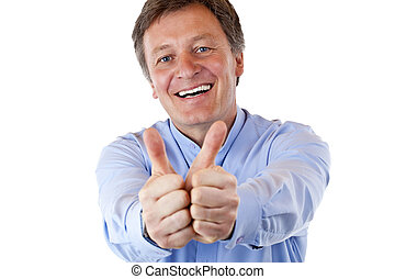 attractive pensioner shows both thumbs up and smiles happy