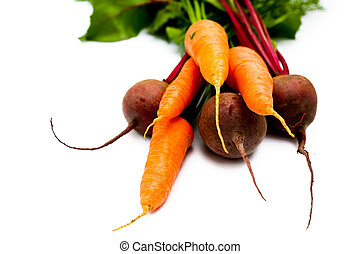 Sweet food - An image of fresh beets and carrots with green...