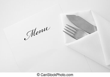 Menu - An image of fork and kife in napkin